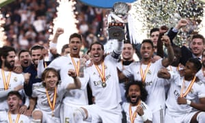 Sergio Ramos (centre) lifts the trophy.