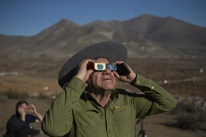 A man looks up at a total solar eclipse in La Higuera, Chile.