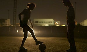 Unstoppable … frequent power cuts mean the women have to train using car headlights, as captured here in Freedom Fields.