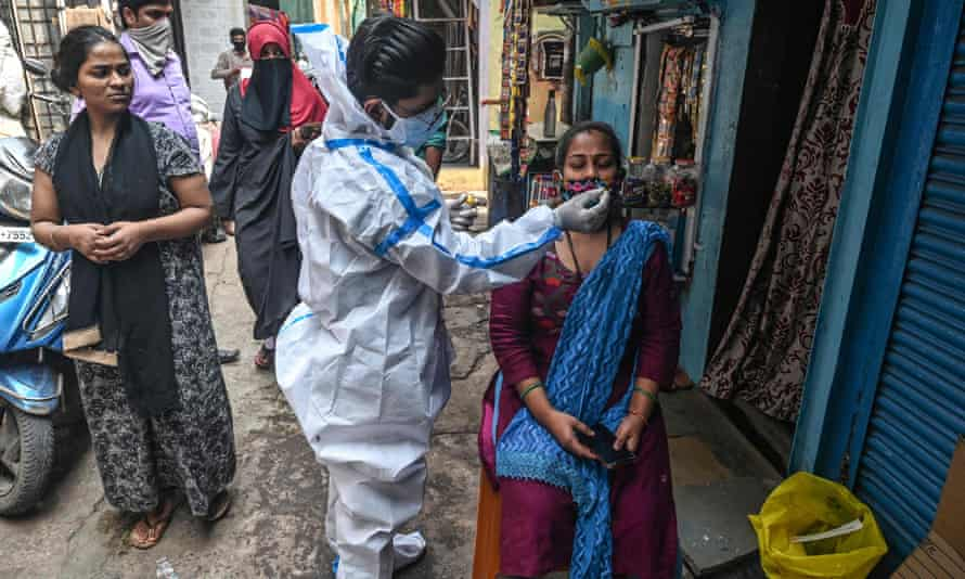 A health worker administers a Covid test in Mumbai