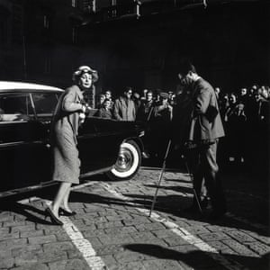 Florentines watch a fashion shoot in Florence, Italy, 1958