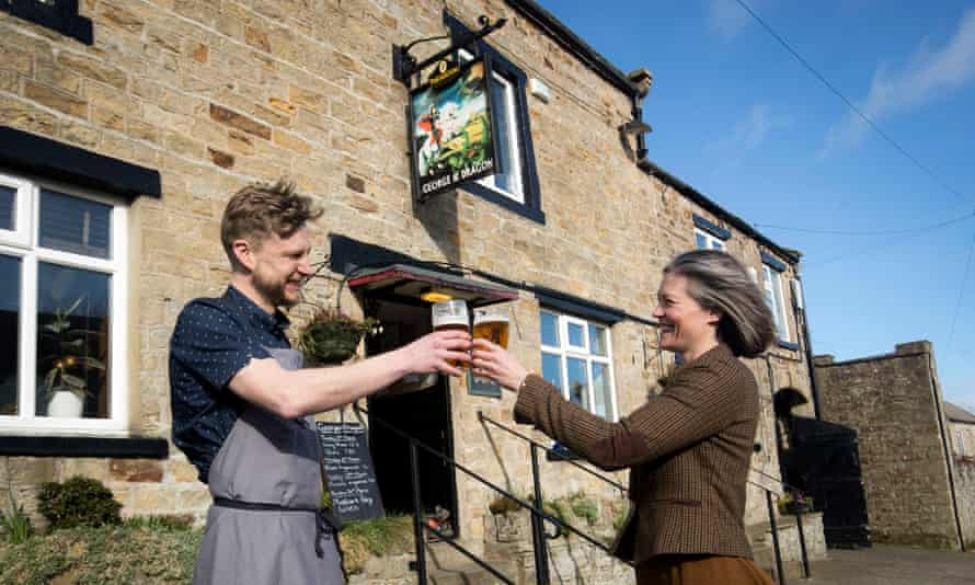George & Dragon landlord Stuart Miller celebrates with his wife, Melissa.