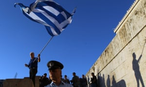 Protesters gather in front of the Greek parliament in Athens to call for the government to resign.