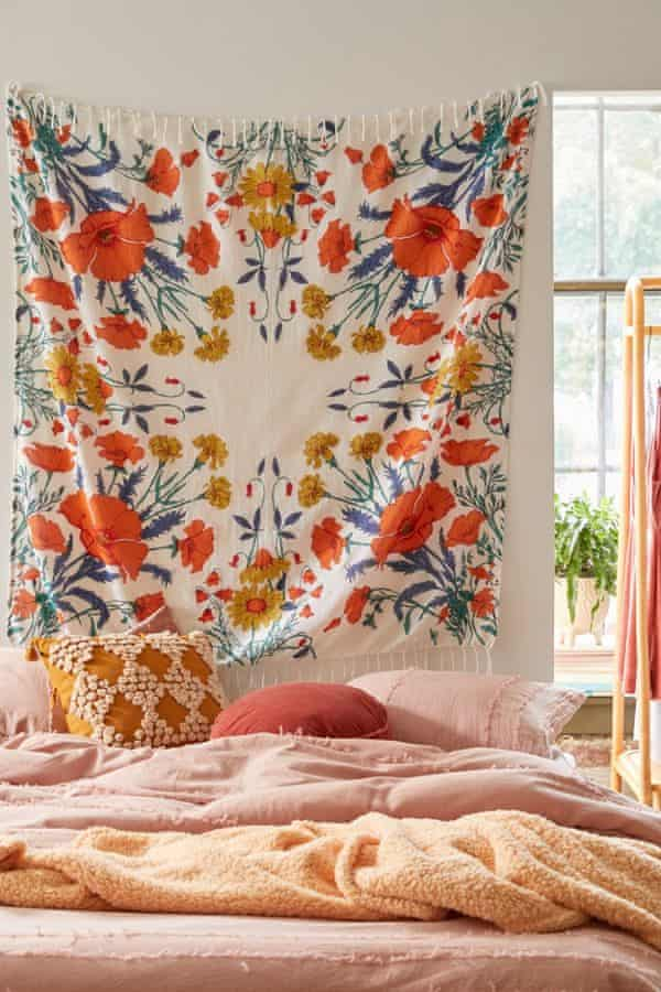 Nicola Shaw, homeware buyer at Urban Outfitters, says wall hangings and tapestries can make your room feel cosy.