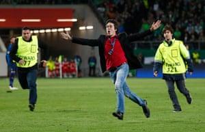 A fan leads the stewards a merry dance.