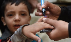 A Pakistani health worker marks a child's finger after administering polio drops during an immunisation campaign in Karachi.