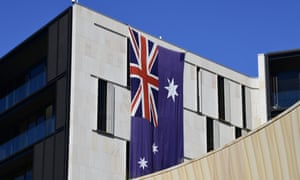 An Australian flag hangs on a building