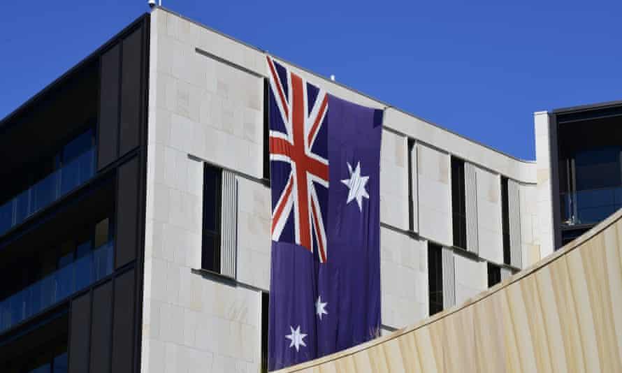 An Australian flag hangs on a building