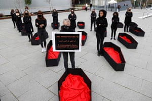 Tel Aviv. A woman outside the district court holds a placard that reads: 'I refuse to be next', as others stand next to mock coffins to represent women killed as a result of domestic violence