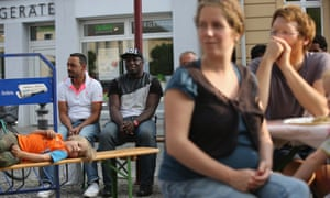 Refugees and locals at a music performance in Bad Belzig, Germany.