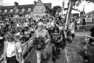 Jeremy Corbyn with his wife going to the church to lay a wreath on the grave of James Hammett who returned to the village after transportation to Australia