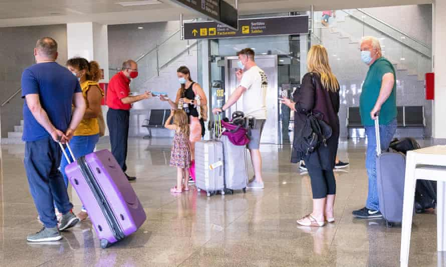 Passengers arrive in Menorca on 1 July on the first flight from the UK since the Balearics were included on the Covid-19 green travel risk list.