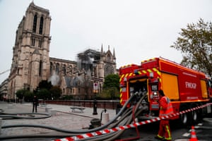 Firefighters secure the area around the cathedral in the aftermath of the fire