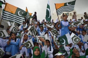 Karachi, Pakistan Girls sing the national anthem as they wave Pakistani and Pakistan-administered Kashmir flags outside the mausoleum of Pakistan's founding father, Quaid-e-Azam Mohammad Ali Jinnah, during Independence Day celebrations in Karachi
