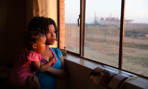 Eleriza Van Rooyen and her daughter Thandeka, aged nine months, can see Kusile power station from their new house. The family was relocated to make way for Kusile.