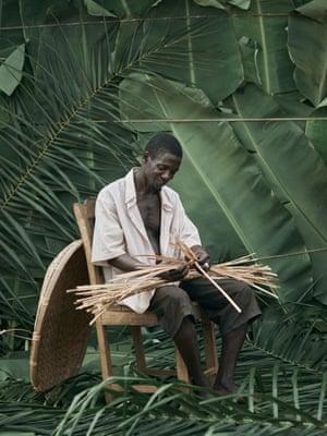 David Komawa, 55, weaving baskets
