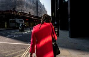 A woman walks along an empty Threadneedle Street, September 2020