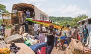 South Sudanese Refugees arrive at a refugee permanent settlement in Uganda
