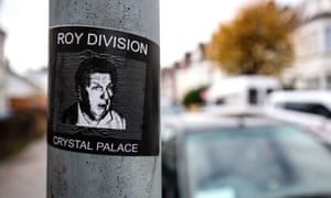 A sticker reading 'Roy Division' with a picture of Roy Hodgson, outside Selhurst Park