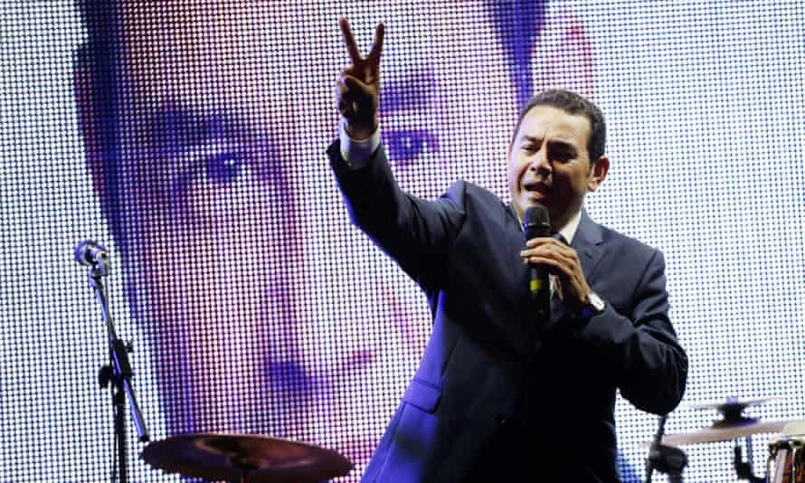 Guatemalan presidential candidate Jimmy Morales flashes the victory sign as he addresses supporters outside his campaign headquarters in Guatemala City on Sunday.