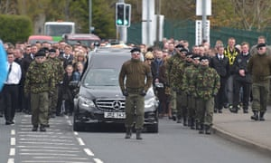 The funeral cortege of Michael Barr on its way to St Mary's Church in Strabane.