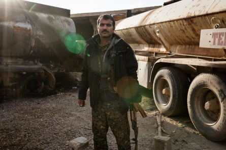 Aram Kochar, a fighter with the Syrian Democratic Forces (SDF) on the outskirts of Baghouz during a lull in fighting to retake it from Isis.