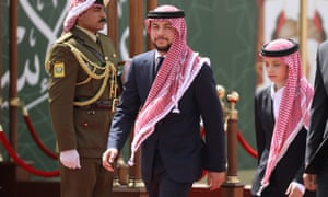 Jordan's Crown Prince Hussein and his brother Prince Hashem attend a ceremony celebrating the country's 73rd Independence Day in Amman, Jordan.