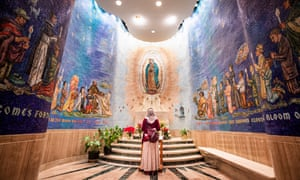 Washington DC, USA woman prays inside the Basilica of the National Shrine of the Immaculate Conception, the largest Catholic church in the US