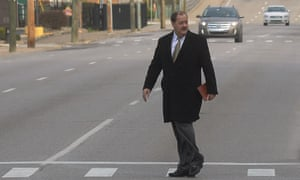 Former Massey Energy CEO Don Blankenship makes his way across Virginia Street in Charleston, West Virginia on Wednesday.