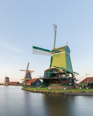 Traditional Dutch Windmill Near A Canal