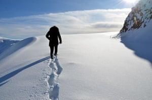 Mus, Turkey. A man walks along a road covered in freshly fallen snow in Mus province