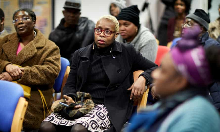 People seek information on delays to compensation payments to Windrush victims at a Home Office briefing in Manchester in January.