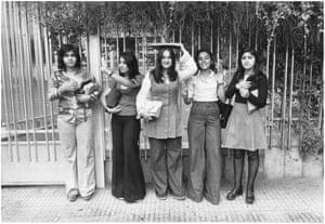 Schoolgirls waiting outside a school in central Tehran