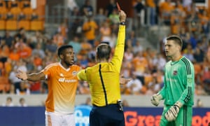 Houston's Jermaine Taylor is sent off against Sporting Kansas City.