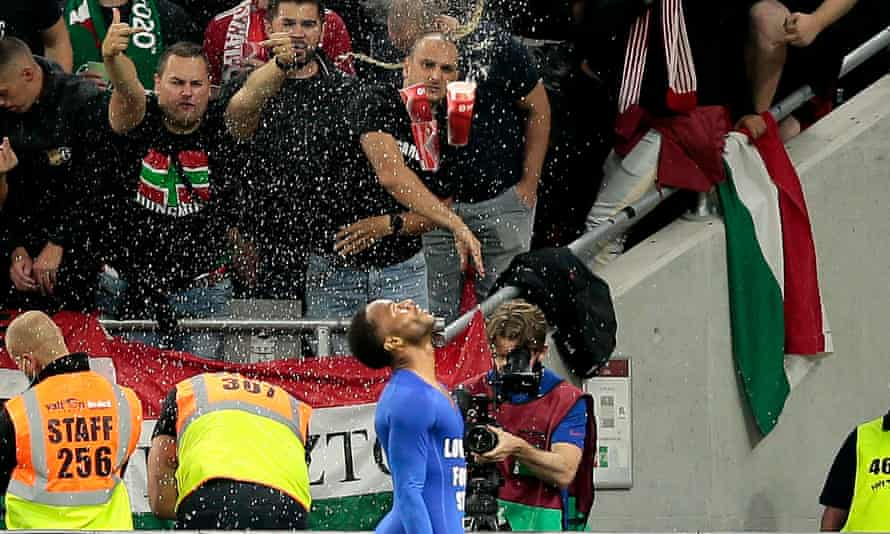 England's Raheem Sterling is pelted by drinks after scoring in Budapest.