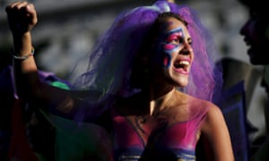 Buenos Aires, Argentina Outside the Congress women with their bodies painted shout slogans during a demonstration to mark International Women's Day and to demand policies to prevent femicides