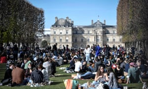 People enjoy the sun at the Jardin du Luxembourg or Luxembourg Gardens in Paris on the second weekend of a new lockdown in France aimed to curb the spread of the Covid-19 cases.