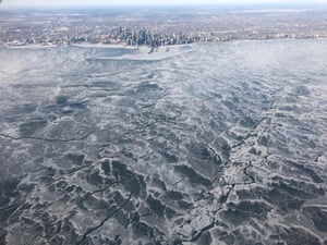 A completely frozen Lake Michigan from above.