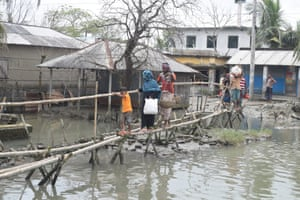 Bamboo bridges have been built across submerged roads.