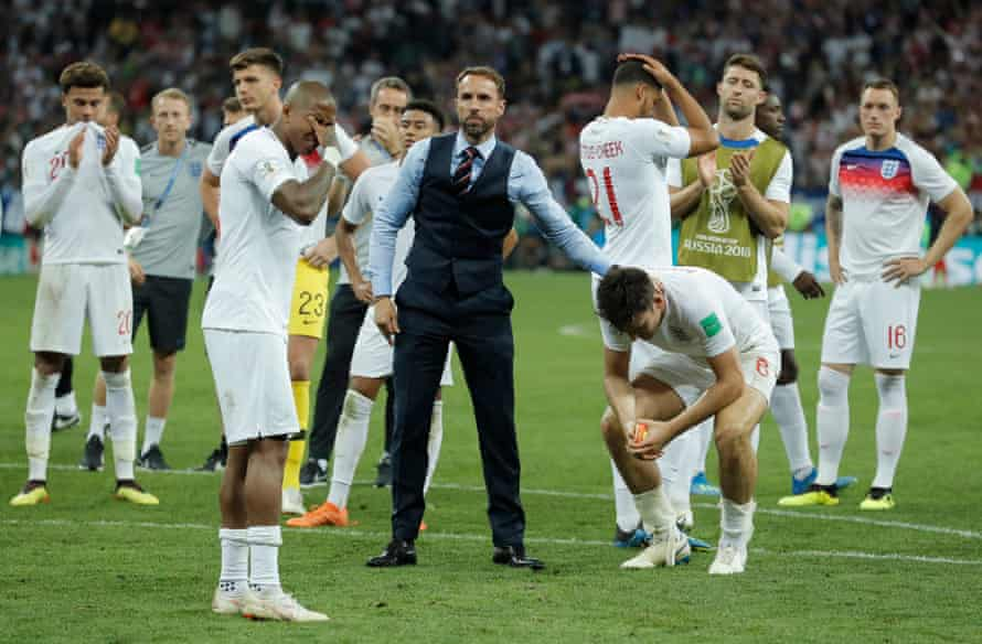 England head coach Gareth Southgate consoles Harry Maguire and the rest of his team after the England v Croatia FIFA World Cup 2018 semi-final