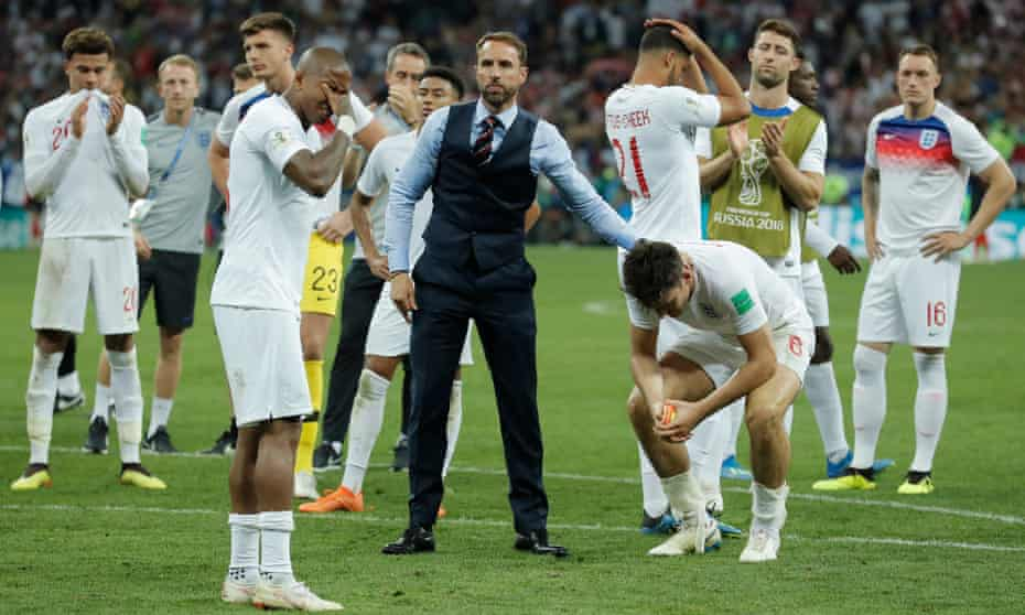 England head coach Gareth Southgate consoles Harry Maguire and the rest of his team after the World Cup semi-final against Croatia.