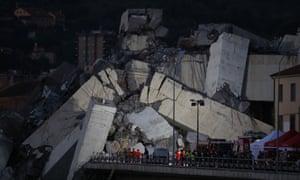 Rescuers inspect the rubble of the Morandi bridge.