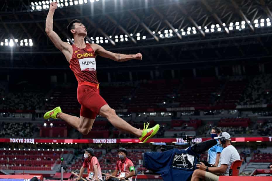 China's Huang Changzhou competes in the men's long jump qualification.