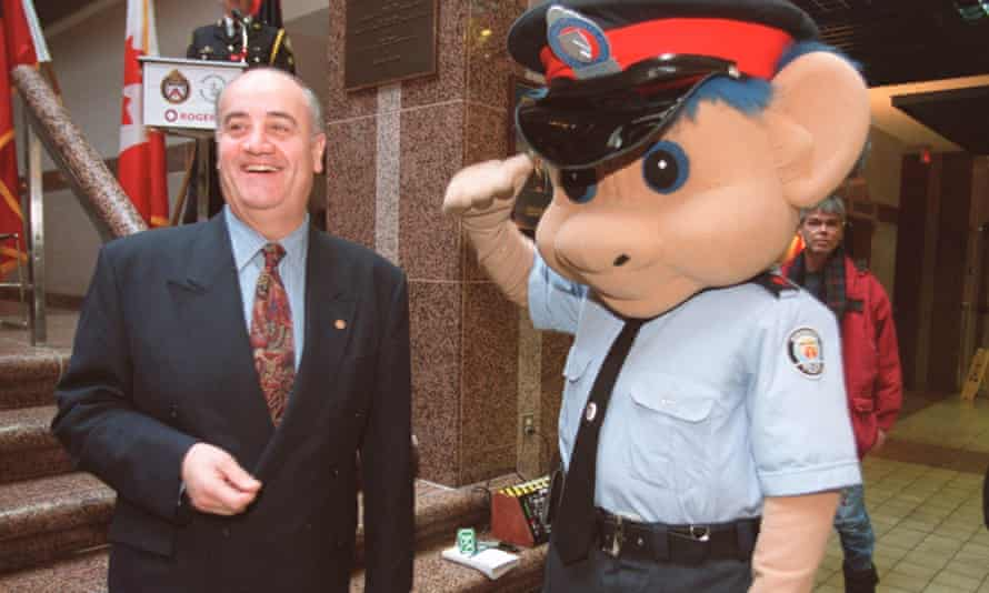 Fantino receives a salute from Officer Pat Troll, a mascot from a series shown to Catholic schoolchildren.