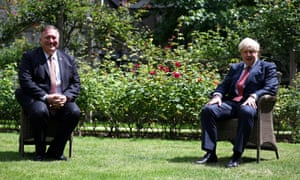 Mike Pompeo (left) and Boris Johnson sit in socially distanced chairs in the garden of 10 Downing Street.