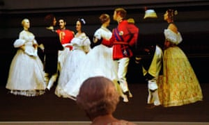 The Queen looks at a creation of a waltz danced at the Crimean Ball of 1856, in the ballroom at Buckingham Palace.