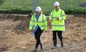 Amber Rudd with the prime minister, David Cameron, at a road development in Bexhill. 'I think the decision last week risks making it a harder road,' she said of the UK's role in tackling climate change.