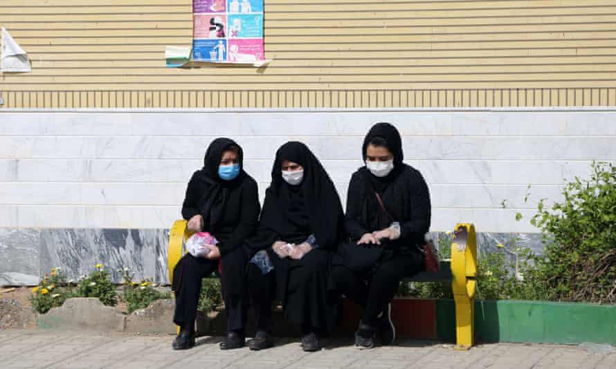Mourners in face masks