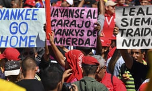 """Workers from Venezuela's state oil company, PDVSA, participate in an """"anti-imperialist"""" march promoted by the government to support Venezuelan President Nicolas Maduro, in front of the Miraflores Presidential Palace in Caracas, Venezuela on January 31, 2019. - The US slapped sanctions on Venezuela's state oil company PDVSA on Monday in an attempt to cut off a vital source of funds propping up Maduro's government. (Photo by YURI CORTEZ / AFP)YURI CORTEZ/AFP/Getty Images"""