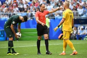 Denmark's goalkeeper Kasper Schmeichel tries to wind up spot-kick taker Mile Jedinak.